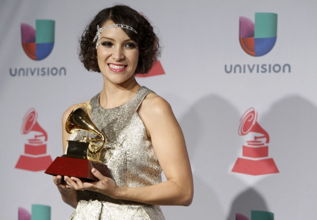 Gaby Moreno poses backstage with her award for best new artist during the 14th Latin Grammy Awards in Las Vegas